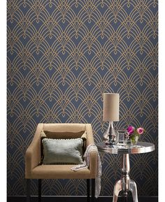 This Astoria Deco Wallpaper features a gold geometric art deco inspired design with mica and glitter elements on a matte dark blue background.