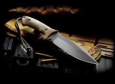 """THE SPARTAN HARSEY MODEL II"" - This knife is Spartan Blades third collaboration with world renowned knife maker, William Bill"" Harsey Jr. The Model II was produced with the combined goal of creating a sturdy knife that double as an excellent field and combat knife. The blade profile, Flat Grind, and top edge of this full tang knife work well on the battlefield and the backwoods alike."