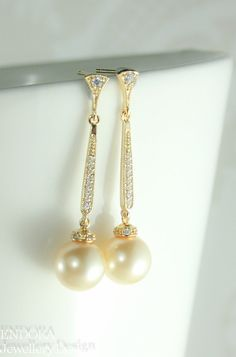 Hey, I found this really awesome Etsy listing at https://www.etsy.com/listing/210404841/champagne-pearl-earringslongpearl