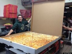 No need to adjust your screen. The picture below features the worlds largest deliverable pizza, complete with the world's largest delivery pizza box. Unfortunately, our drivers can't lift that much. But the pizza we deliver is delicious enough you'll overlook that. #world's #largest #pizza #Cafe1626