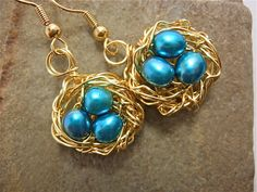 shiny golden copper nest earrings with sky blue freshwater pearl eggs
