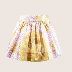 Livly is a lovely Swedish designer which draws its inspiration from folk-law and historical patterns. This lovely fully lined baby pink skirt comes with a Rococo motif of people riding elephants and camels in gold detail. It is pleated and has a lovely under-skirt to help keep your daughter cool in the summer. #FancyKids #London #Fashion #Kids #Eco #Cotton #Natural #Children #Mayfair #Eco-Friendly #Colour