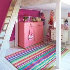 Pink bedroom walls and chest of drawers