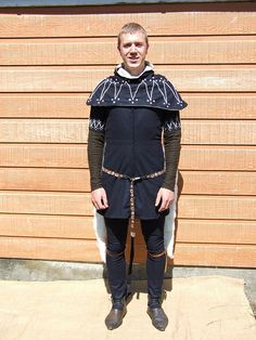 English male set of clothes from the late 1350's. Items: hose, hood and cote (to be worn with appropriate 'middle layer' garment).