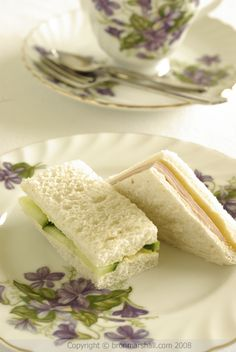 Tea:  Floral china in shades of lavender and white, with finger sandwiches for tea time.