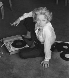 Marlene Dietrich 1957 listening to music on record player