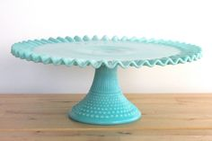 """Turquoise milk glass, """"Hobnail"""" pattern with ruffled rim, cake stand made by Fenton ca. 1950s"""