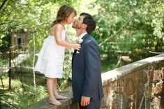 Sweet shot. Groom or bride with kid(s) in the wedding. Could do this with the girls.