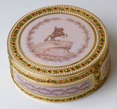 This Fabergé green, red, white and sepia enamel box has views in enamel of two monuments in St Petersburg: the statue of Peter the Great and the Sts Peter and Paul Fortress (on the underside). It was probably made in 1903 to coincide with the two hundredth anniversary of St Petersburg. Mark of Henrik Wigström.