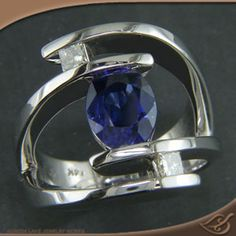 Custom made 14kt warm white gold bypass style mounting holding customer provided 1.97ct oval cut blue sapphire. (ref #84975) - See more at: http://www.greenlakejewelry.com/gallery/cust_gallery.aspx?ImageID=84975#sthash.aKJAFgHX.dpuf
