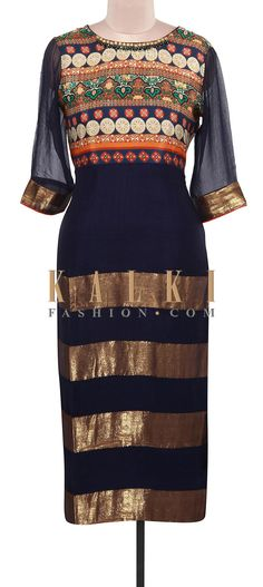 Buy Online from the link below. We ship worldwide (Free Shipping over US$100). Product SKU - 309096.Product Link - http://www.kalkifashion.com/navy-blue-kurti-enhanced-in-print-and-lurex-only-on-kalki.html