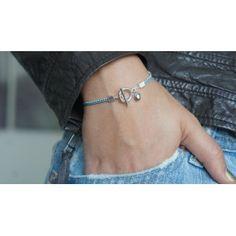 Bracelet perle de Tahiti, chaîne boule en argent et cordon polyester. Fermoir bâton argent. Modèle LINE.