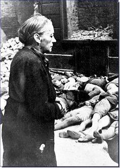Braunschweig, Germany. An elderly German lady watches bodies of German boys killed in Allied air raids. Image Source: Deutsches Bundesarchiv (