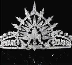 The fabulous Sunburst tiara of Bavaria. This piece was a gift to the Infante Maria de la Paz, by her mother (Queen Isabella of Spain), when she wed Prince Ludwig of Bavaria in 1883. The central fleur de lys motif shows it's Spanish heritage. However, needs must and it was sold via Sotheby's on 14 May 2013 for CHF173,000.