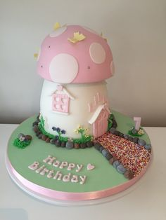 Toadstool house for fairies, the cake is vanilla sponge and has butter cream as a crumb coat. A dowel rod runs all the way through the cake for support.