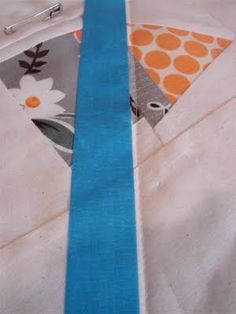 Tutorial for machine quilting straight lines using painters tape rather than marking the quilt.
