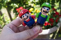 Mario and Luigi 2 Piece Set - Super Mario Brothers Party Cupcake Toppers - Polymer Clay. $20.00, via Etsy.