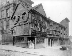 The building known as the Wellington Inn has existed since 1552 when Edward VI was on the throne. At that time it was situated in the Market Place and Shambles. It is now the oldest building in Manchester. It's been picked up & moved twice & it's still standing!   Ref no: m03701