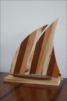 Great gift for a sailboat collector: http://www.woodsmithofnaples.com/category-s/1514.htm