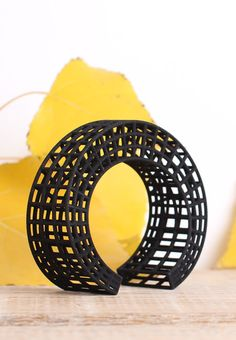 Black Cuff Bracelet in an architectural style. The 3d printed constraction is made of Nylon. It is very light and pleasant to wear.