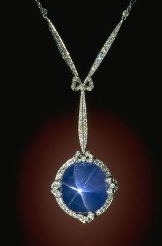 Corundum (variety: Star Sapphire) This art deco-style necklace features a sky blue star sapphire in a platinum setting accented with 126 diamonds. The necklace was designed by Marcus Antique Jewelry, Vintage Jewelry, Sapphire Necklace, Sapphire Jewelry, Lotus Necklace, Drop Necklace, Flower Necklace, Gemstone Earrings, Belle Epoque
