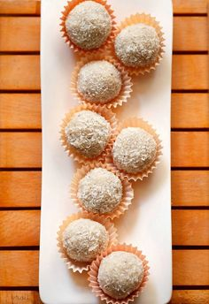 coconut ladoo recipe with condensed milk. quick and easy coconut ladoo recipe with step by step photos. also posted coconut ladoo recipe made with desiccated coconut and sugar syrup
