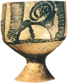 A slip decorated goblet from Tepe Hissar in Iran c.3000BC. In this early example of Iranian pottery decoration the stylistic characteristics were already established. But the new development shown here is that the bowl has a stem. Each part was made separately on a turntable and then stuck together. The pottery goblet (or stem bowl) begins to appear in Western Asia as the turntable or pottery wheel came into use.