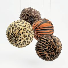 """Paradise Safari Party Lanterns. Go wild! Adorn your party walls or ceiling with our Paradise Safari party lanterns for a true jungle-like atmosphere. Featuring assorted animal print styles, these paper lanterns look great alone or hung with garland! Includes metal hanger. 10"""" © OTC"""