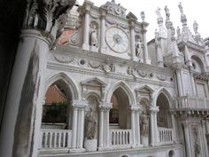 Portico Clock by Bartolomeo Monopola  -- Doges' Palace, Venice, Italy - Along this north façade in the courtyard, we have a mix of styles We have Bartolomeo Monopola's clock and antique sculpture.