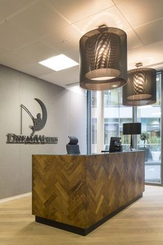 Office Interior Design | #Parquet reception #desk for Dreamworks UK