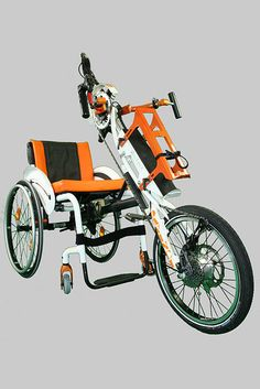 Da Vinci Handcycle Electric Assist Power Trike Adapter with 8 Speed Mountain Drive fitted to a Quickie Helium Wheelchair, the mountain drive doubles the gears by giving an extra 8 extremely low gears making it a 16 Speed hand-bike that attaches in seconds