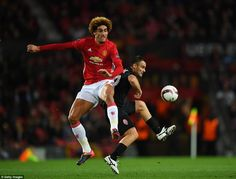 Belgian Marouane Fellaini (left) battles for the ball in midfield with 35-year-old Serbian Zeljko Ljubenovic