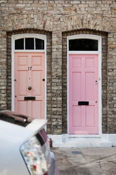 A colored front door is a must. peach + pink are great options.