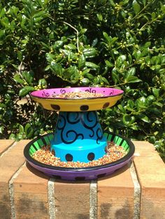 Hand painted 2 tier bird feeder using pot and 2 saucers