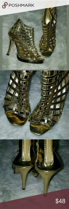 Pierre Dumas Caged Metallic Gold Platform Stiletto Pierre Dumas Caged Metallic Gold Platform Stiletto Heels 7M  Gorgeous shoes! Indents from storage on heels. Not very noticeable especially when worn.   4.25 inch heel. .25 inch platform.   LB Pierre Dumas Shoes Heels