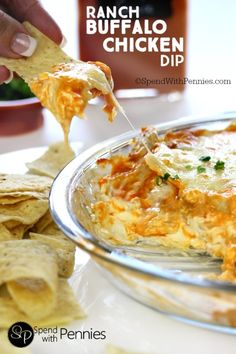Ranch Buffalo Chicken Dip is the perfect party recipe!  Creamy, cheesy & spicy we love serve this with warm chips or celery sticks!   (If you're a bleu cheese fan, you can certainly sub it in)!