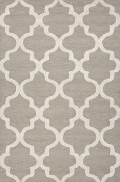 Over scaled sharp geometrics characterize this striking contemporary range of hand tufted rugs. The high/low construction in wool and art silk creates texture a