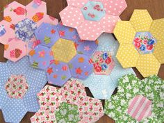 pink, green, yellow, aqua, periwinkle hexie quilt