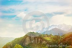 Panoramic view of colorful landscape of Italy with a mountains and blue cloudy  sky at sunny day