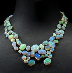 """Eighty-seven Australian crystal opal cabochons form the """"Path of Enlightenment"""" opal necklace and earrings. Designed by Karin Stirnemann, the approximately 148 carats of opal used in the necklace and earrings (detatchable from the necklace) are set in platinum."""
