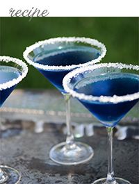 Midnight Blue martinis for cocktail hour. For a little extra pop, you can sprinkle white, silver, or gold sugar along the rim of the glass.