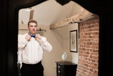 Great shot of our Model Tom getting ready into his evening attire! we stock a wide range of eveningwear from tail suits for white tie functions, white tuxedos for cruises and a range of black diner suits too.