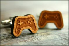 Two detailed laser cut wood video game controllers adorn metal cuff links. The perfect gift for the gamer in your life. Laser cut cherry wood