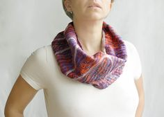 https://flic.kr/p/bVdetJ | Nuno felted orange purple cowl urban scarf wool silk | Cowl scarf hand felted in nuno technique of very fine merino white wool and silk in orange and purple. The scarf is bright and fun. A beautiful combination of orange and purple makes it a perfect accessory for the summer.   You can style the cowl scarf the way you like. It's very soft, thin, light, and will fit any neck. There is no need to wrap it up around your neck. The scarf is very easy to wear and style…