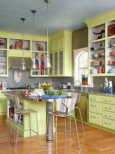 Choose a vibrant color for the kitchen cabinets. The chartreuse cabinets pair perfectly with the oak floors.