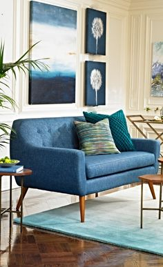 Fall in love with the graceful simplicity of mid-century modern style with our Tilda Fabric Loveseat.