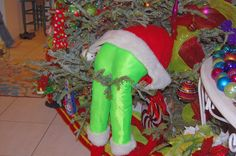 Grinch in tree - Whoville decor DIY was so much fun to have in the Christmas tree decor. Love the lime green pants.