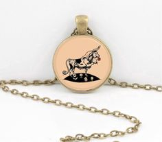 Check out Ferdinand the Bull Classic Children's Story Glass Pendant Necklace or Key Ring on northstarpendants