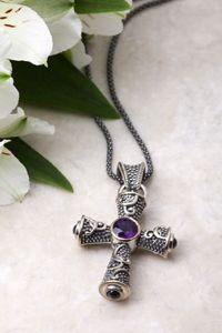 14K & Sterling Silver Cross Pendant with Genuine Amethyst & Sapphire $200.00 http://www.celebrateyourfaith.com/14K-amp-Sterling-Silver-Cross-P4891C1700.cfm