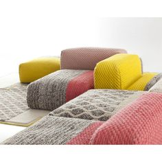 Mangas Space by Patricia Urquiola. Mangas Space by Patricia Urquiola couch and carpet.